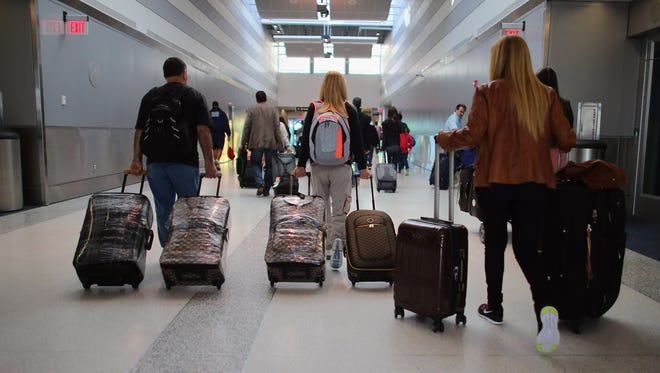 Passengers walk through Miami International Airport on the day before Thanksgiving, Nov. 21, 2012.