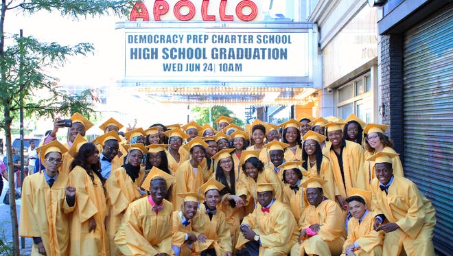 Students from Democracy Prep Public Schools pose on graduation day at New York's Apollo Theater. The network says nearly nine in 10 alumni are on track to earn a four-year degree.