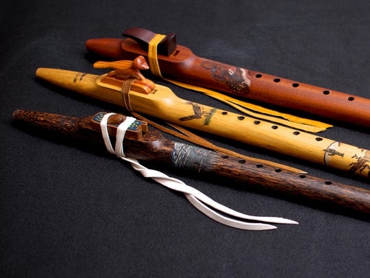 John Ellis, who performs as Johnny Kee, makes beautiful wooden flutes for his company Turtle Mound Flutes. At top is the Johnny Kee flute, showing an image of himself and made of sapele; in the middle is the roadrunner design, made from spalted hackberry; and at bottom is the manatee flute, made from black palm.