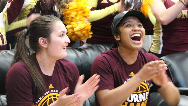 Iona's Cassidee Ranger, left, and Aaliyah Robinson celebrate as their spot is announced in the NCAA women's basketball tournament March 14, 2016.