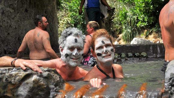 Pam and Eric Maunz of Monroe, enjoy the Mud Baths at the Soufriere Volcano in St. Lucia.