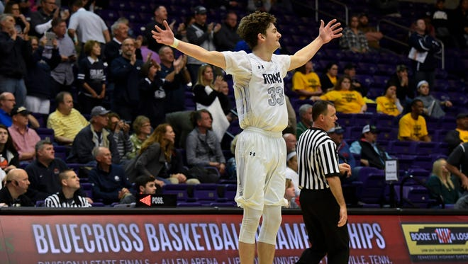 Grace Christian guard CJ Gettelfinger (33) celebrates their 44 to 39 victory over The Webb School after their semi-final game in the TSSAA Division II basketball state championships at Allen Arena Thursday, March 1, 2018 in Nashville, Tenn.