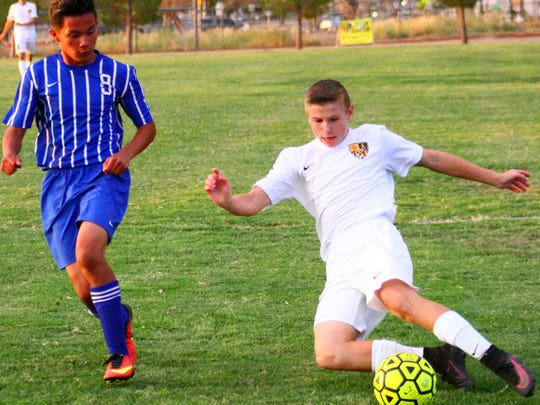 In addition to playing football, Brett Money, right, also played varsity soccer. He has a bright future on the horizon.