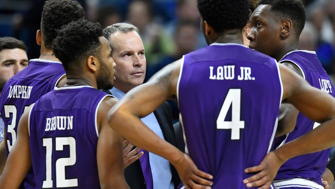 Northwestern fourth-year coach Chris Collins talks with his team during its win Tuesday at Penn State. The 12-2 Wildcats have a roster and resume poised to make a run at an NCAA tournament bid.