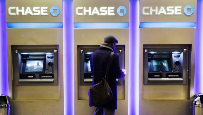 A customer uses an ATM at a branch of Chase Bank, in New York.