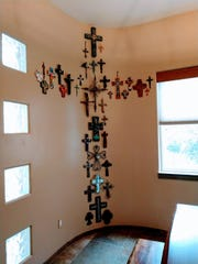This wall of crosses is featured in the home of Paul