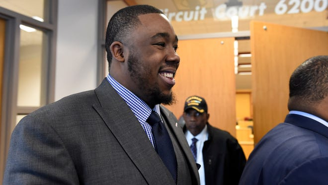 Nick Fairley smiles as he walks out of circuit court during a lunch break in his 2012 DUI and reckless driving case at Mobile Government Plaza on Feb. 11, 2015. Fairley was acquitted of the DUI charge on Friday.
