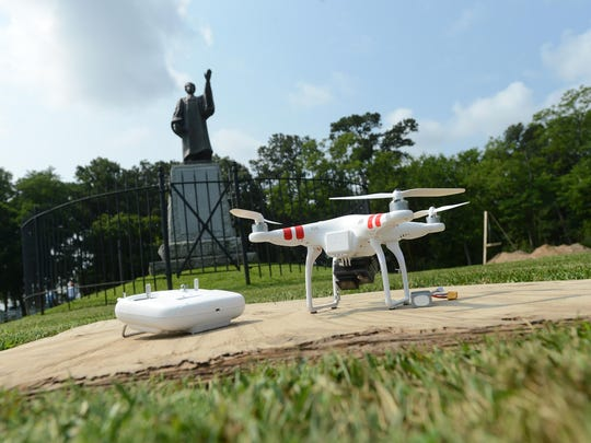 A drone sits near a statue of Francis Makemie at an