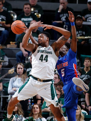 Michigan State's Nick Ward (44) is fouled by Savannah