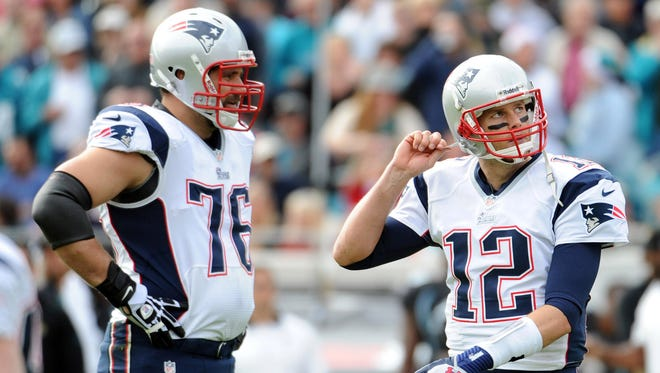 New England Patriots quarterback Tom Brady (12) and offensive tackle Sebastian Vollmer (76) react to a play during the first half of the game against the Jacksonville Jaguars at EverBank Field.