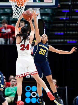 Nebraska Cornhuskers guard Maddie Simon (24) attempts a shot past Michigan Wolverines guard Deja Church (20) in the second period during the third round of the Big Ten Conference Tournament at Bankers Life on Friday, March 2, 2018.