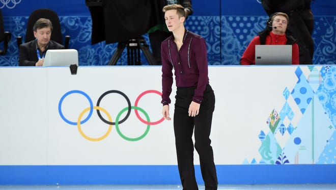 Jeremy Abbott (USA) reacts after performing during the figure skating team men short program in the Sochi 2014 Olympic Winter Games at Iceberg Skating Palace.