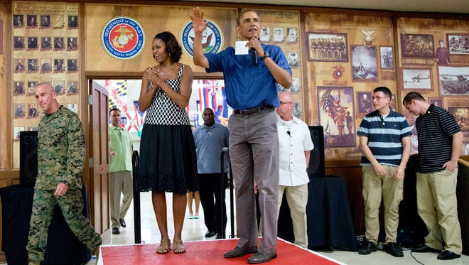 President Obama and first lady Michelle Obama arrive to speak to members of the military and their families at Marine Corps Base Hawaii.