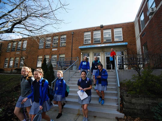 Students leave Mother of Mercy High School Thursday