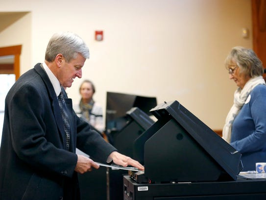 Sheriff Patrick O'Flynn casts his vote at the Dolomite