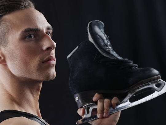 Adam Rippon holding one of his ice skates.