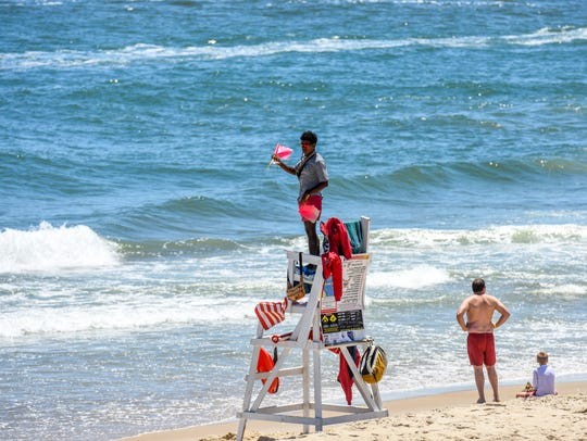 A lifeguard watches over the Ocean City beach on Monday.