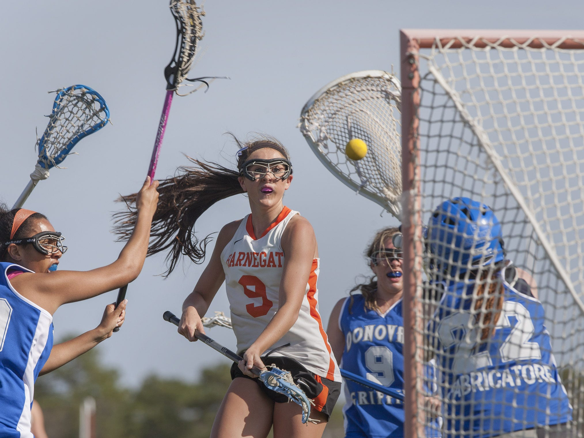 Barnegat's Nicole Federovitch shoots and scores against Monsignor Donovan goalie Kelly Fabricatore during first-half lacrosse action on Monday. Peter Ackerman/staff photographer Barnegat's Nicole Federovitch shots and score during first half action against Monsignor Donovan goalie Kelly Fabricatore. Monsignor Donovan vs Barnegat Girls Lacrosse on April 14, 2014 in Barnegat. Peter Ackerman/Staff Photographer