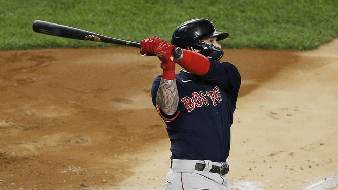 Red Sox left fielder Alex Verdugo hits a solo home run against the Yankees during the fourth inning of Friday night's game.