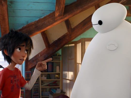 Hiro Hamada, voiced by Ryan Potter, left, and Baymax,