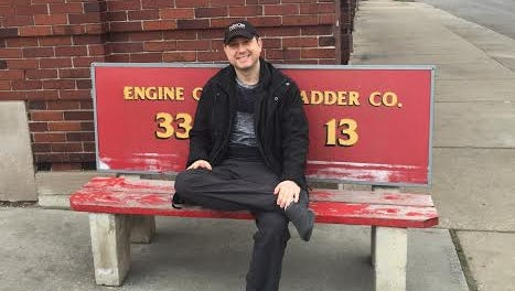Hillside Furniture president Jeff Selik takes a seat in front of the Detroit Firehouse Co. 33 Ladder 13 on Lawndale. His company donated $25,000 worth of furniture to the fire house last week.