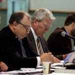 Rep. Eric Turner, R-Cicero, second from right, looks over notes during a Budget Committee meeting at the Indiana State Fairgrounds Wednesday, April 23, 2014, in Indianapolis. Rep. Turner did not attend his House Ethics Committee hearing at the Statehouse. (AP Photo/Darron Cummings)