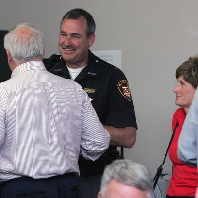 Coshocton County Sheriff Tim Rogers shakes hands with