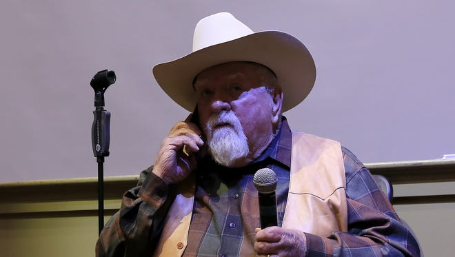 """Actor Wilford Brimley answers his phone in the midst of a presentation Wednesday at the Electric Theater in St. George. He told the caller, """"I'm in a theater right now being a big shot."""""""