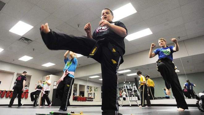 Caleb Raymond, during a champs class at Premier Martial Arts in Raynham on Tuesday, Oct. 20, 2020.
