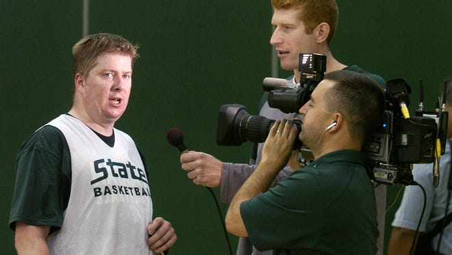 Longtime MSU beat writer Joe Rexrode is interviewed by MSU's Drew Naymick following a practice session held for members of the media at Breslin Center in 2007.