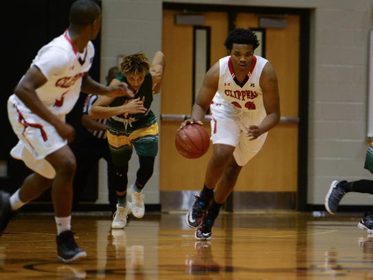 Bennett's Harold Morton brings the ball down the court after the rebound against Mardela on Wednesday.
