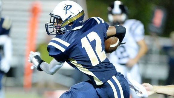 Micah Jenkins (12) and Roberson play at Erwin on Friday.
