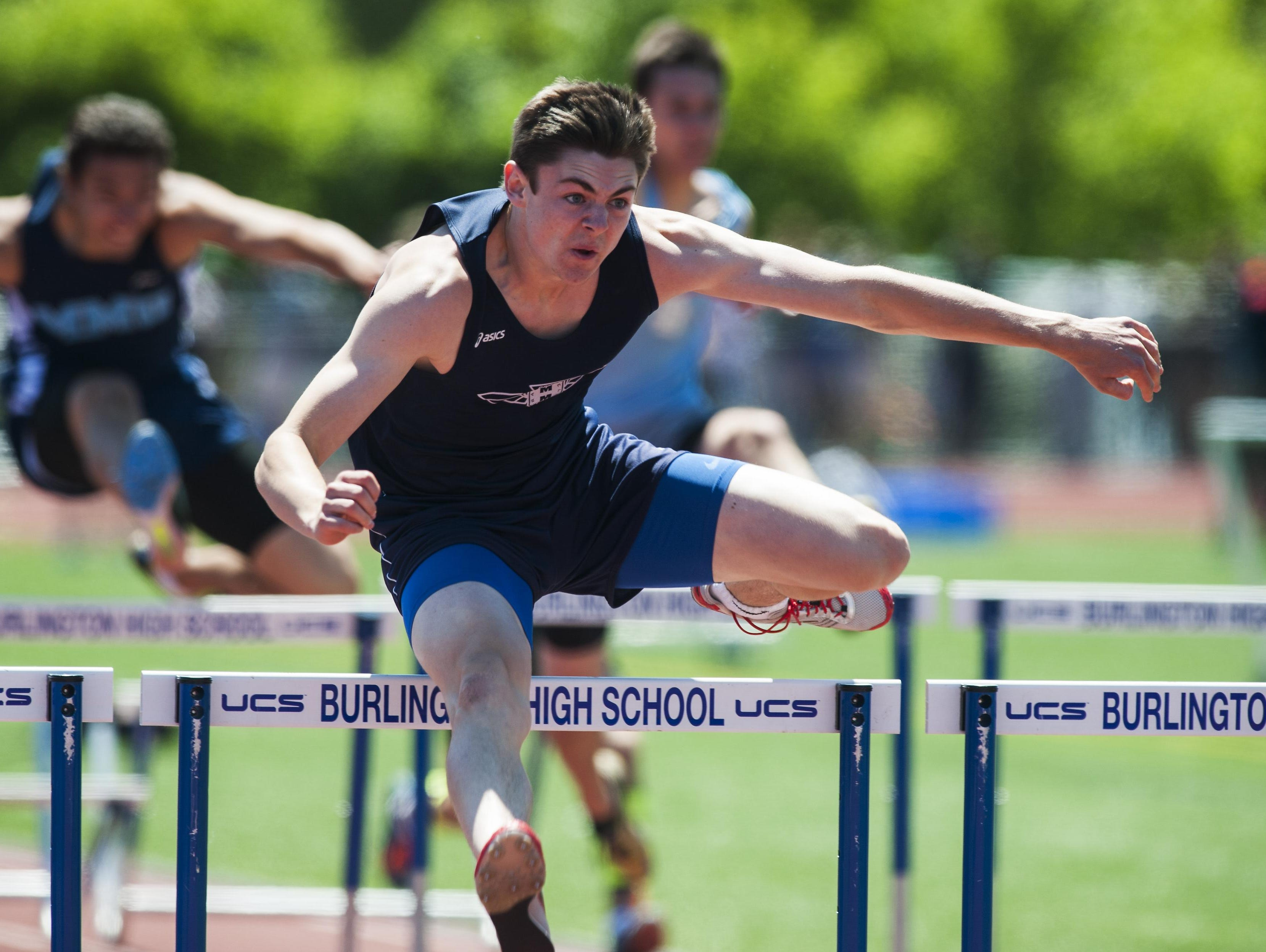 Mount Mansfield's Alec Eschholz competes in the 110m hurdles race during the high school track and field state championship meet at Burlington High School on Saturday June 6, 2015 in Burlington, Vermont.