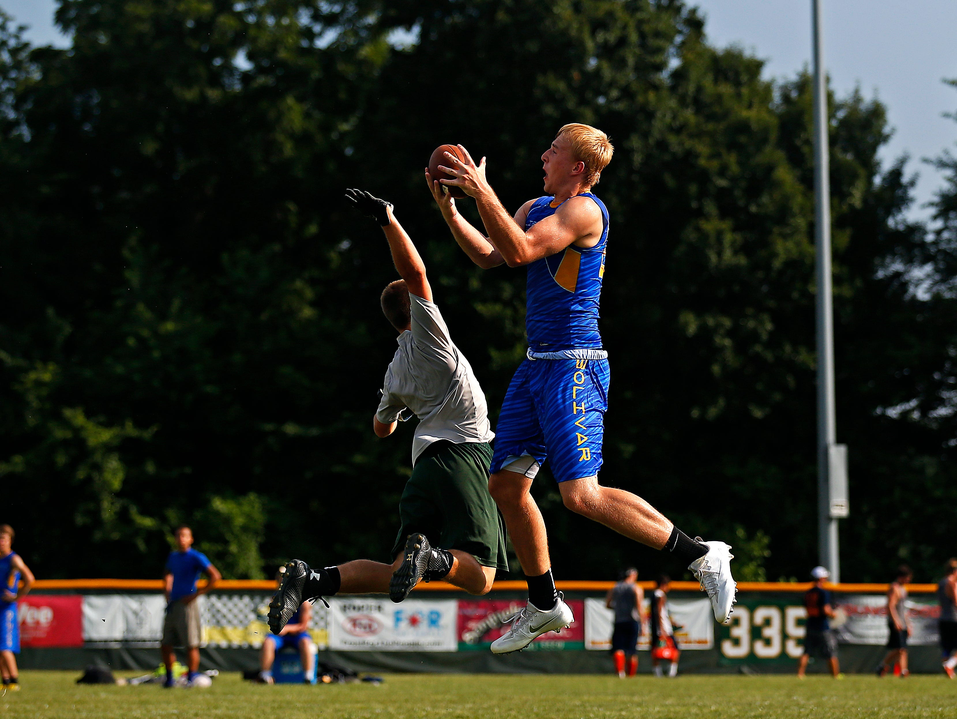 Bolivar High School wide receiver Brandon Emmert catches a pass over a defender as the Liberators play Mt. Vernon High School during the 2016 Parkview 7 on 7 Tournament held at JFK Stadium in Springfield, Mo. on June 16, 2016.