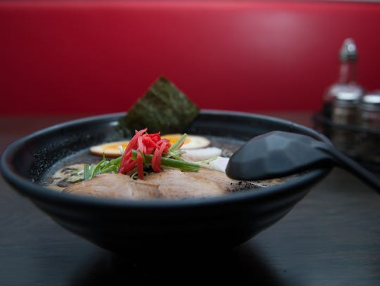 A Black Garlic Ramen dish is shown at the Rayaki Restaurant