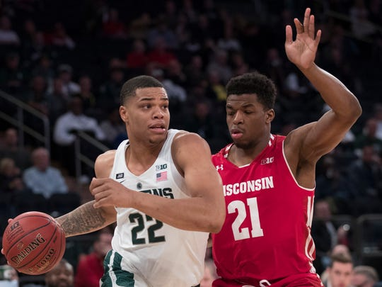 Michigan State forward Miles Bridges (22) drives to