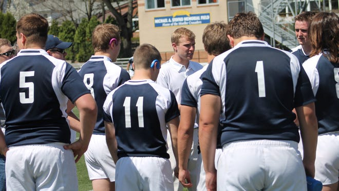 Coach Steve Kuhlman addresses Moeller's rugby squad after a 31-0 triumph over Pickerington on April 12.