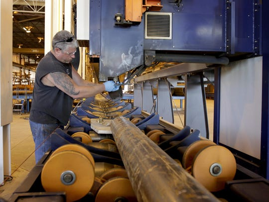 Jeff Safford works with a HGG profiling machine at