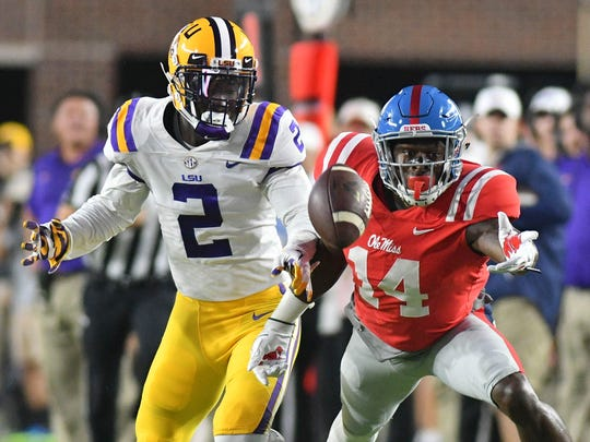 LSU Tigers cornerback Kevin Toliver II (2)  and Mississippi Rebels wide receiver D.K. Metcalf (14) battle for a pass during the first quarter at Vaught-Hemingway Stadium in Oxford, Miss. Oct. 21, 2017.