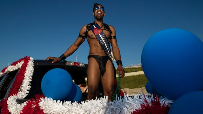 James Lee, the International and Kentucky Mr. Leather winner, rides in the back of a truck during the 2018 Kentuckiana Pride Fest Parade on Friday evening in downtown Louisville. June 15, 2018
