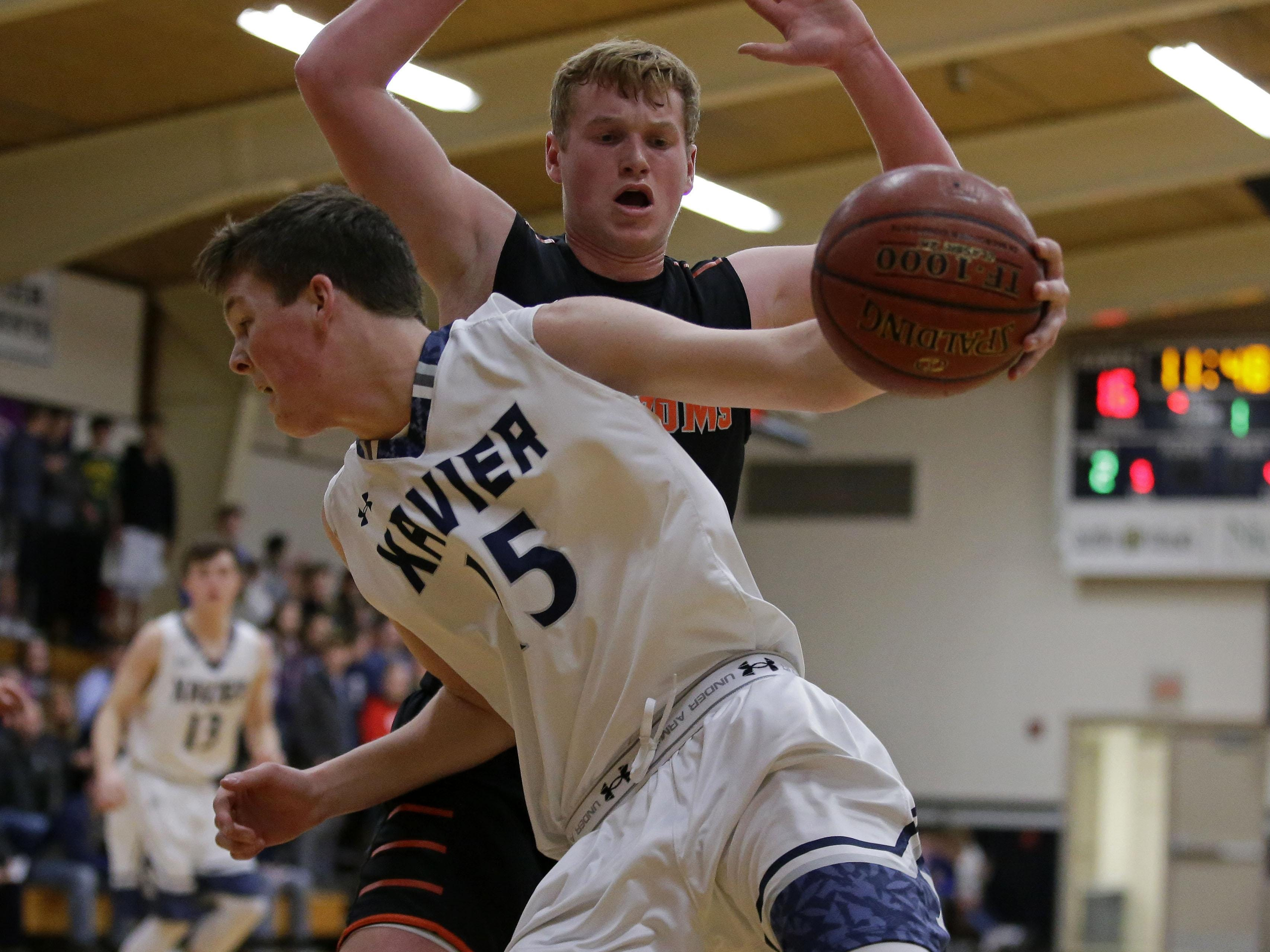 Nate DeYoung of the Xavier Hawks works the baseline against Jake Karchinski of the West De Pere Phantoms in Bay Conference basketball Thursday, February 9, 2017, at Xavier High School in Appleton, Wisconsin.Ron Page/USA TODAY NETWORK-Wisconsin