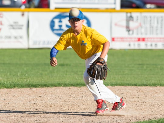 A Fruitland shortstop prepares to catch a bouncing ground ball during practice at Fruitland Little League on Monday, July 31, 2017.