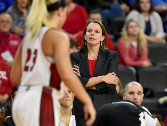 USD head women's basketball coach Dawn Plitzuweit reacts