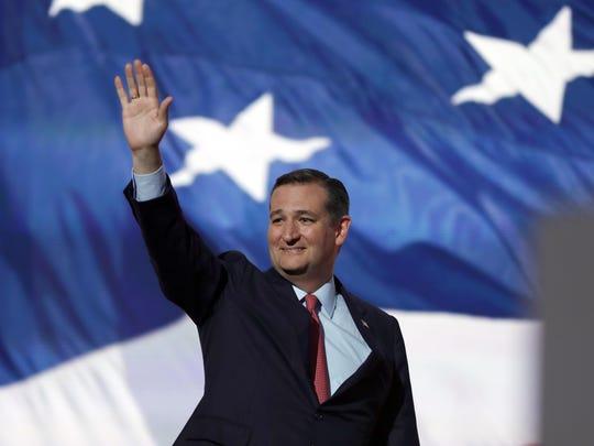 Sen. Ted Cruz, R-Tex., waves before addressing the