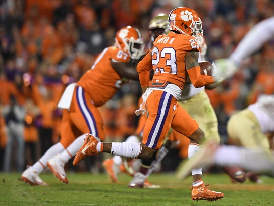 Clemson defensive back Van Smith (23) returns the ball
