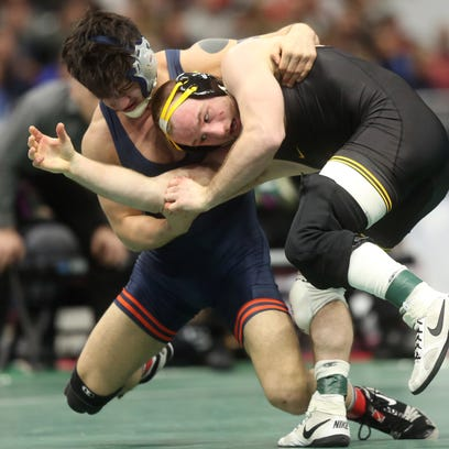 Iowa's Alex Marinelli wrestles Illinois' Isaiah Martinez