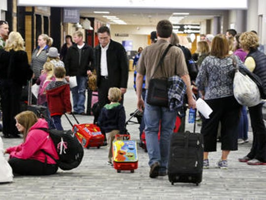 A terminal filled with fliers at the Des Moines International Airport.