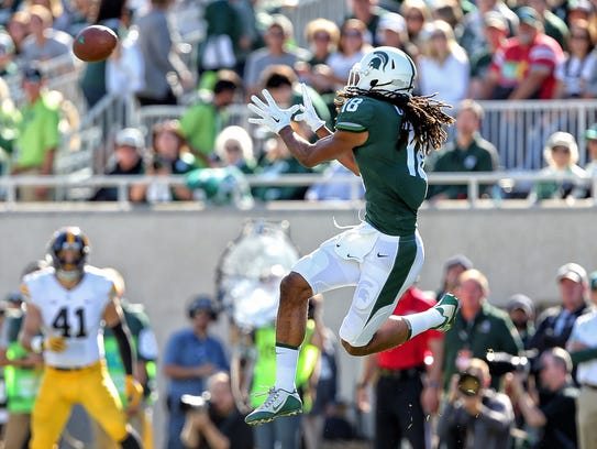 Michigan State receiver Felton Davis III leaps to make