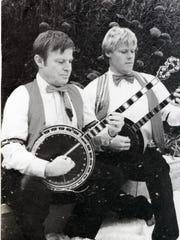 Bob McKinnon, left, plays banjo with his son, Chris.