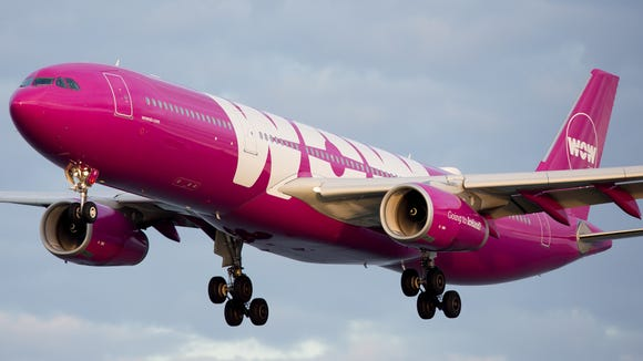 Clad in distinctive purple, a WOW Airbus A330 lands